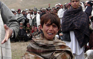 Boy crying at funeral in Afghanistan