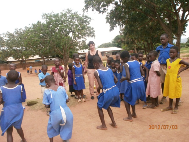Maria playing with ECOC kids