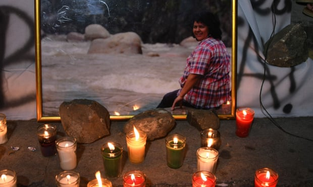 Candles in front of a picture of Berta Caceres